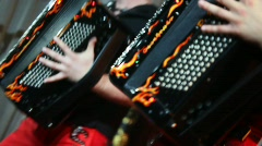 Two accordion player perform at concert Stock Footage