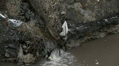 Polluted water flows into an irrigation ditch. Stock Footage