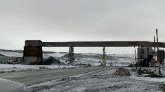 Pan across an old abandoned mine in winter with traffic Stock Footage