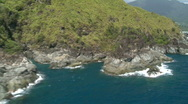 Stock Video Footage of Aerial flight along rocky ocean cliff with forest