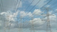 Stock Video Footage of Time lapse of clouds moving behind high tension wires and