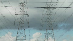 Time lapse of clouds moving behind high tension wires and - stock footage
