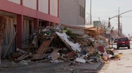 Stock Video Footage of Junk is piled up in the wake of the devastation of