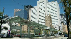 A rapid transit train moves quickly through downtown - stock footage