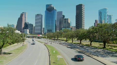 Cars drive along a highway leading into downtown Houston. Stock Footage