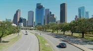 Stock Video Footage of Cars drive along a highway leading into downtown Houston.