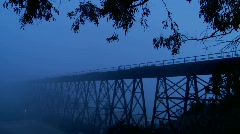 An Amtrak passenger trains speeds across a bridge in the Stock Footage