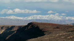 Time lapse of clouds moving over Death Valley mountains. Stock Footage