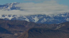 A slow move back on a time lapse of a beautiful mountain Stock Footage