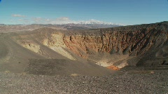 Pan across a volcanic crater in Death Valley National Park. - stock footage