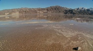 Stock Video Footage of A pan across a lake of badwater in Death Valley National Park.