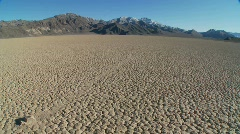 The mysterious rocks which race across the dry lakebed - stock footage