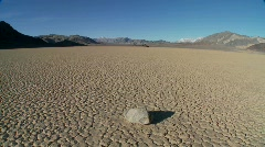 The mysterious rocks which race across the dry lakebed Stock Footage