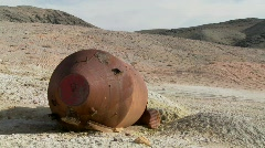 What looks like an old space capsule has crash landed in the desert. Stock Footage