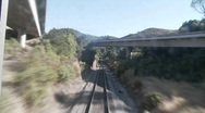 Exciting POV shot point of view of a train down tracks and Stock Footage
