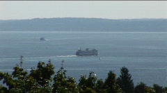 Ferries move slowly across a lake. Stock Footage