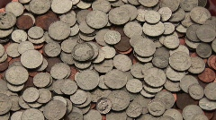A pile of change sits on a table. Stock Footage