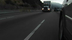 Cars and trucks drive by on a crowded highway. Stock Footage