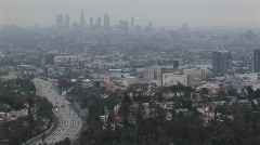 Smog hangs on the distant cityscape. - stock footage