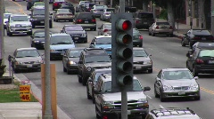 Congested traffic slowly moves along on a city street. - stock footage