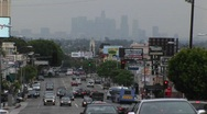 Congested traffic passes on a city street. Stock Footage