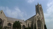 The sun shines on a large church. Stock Footage
