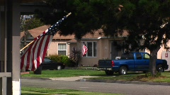 An American flag waves in a residential area. Stock Footage