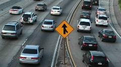 Vehicles slowly merge into traffic. Stock Footage