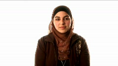 A woman wears a headscarf, underscarf and sweater. Stock Footage
