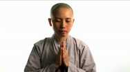 A young Buddhist monk prays. Stock Footage