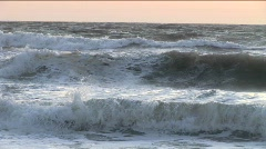 Choppy waves continuously break and roll onto shore. Stock Footage