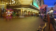 Stock Video Footage of A time lapse at night of people sitting and walking in Las Vegas.