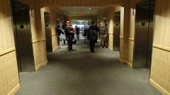 A time lapse of hotel patrons as they enter and exit elevators. Stock Footage