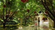 Stock Video Footage of A time lapse of pedestrians walking through a garden.