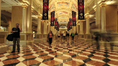 A time lapse of pedestrians walking around a lobby. Stock Footage