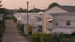 Rows of homes near a walking path at a trailer park. Stock Footage