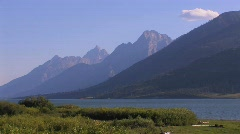 A wilderness lake and layers of mountains. Stock Footage