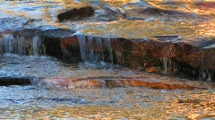 Water flows over flat rocks at Tuolumne Meadows in Yosemite Stock Footage
