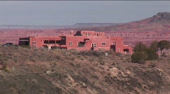 An adobe house occupies the desert in New Mexico. - stock footage