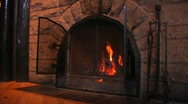 Stock Video Footage of Wood burns in a fireplace.