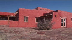 An adobe house occupies a desert plain in New Mexico. Stock Footage