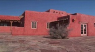 Stock Video Footage of An adobe house occupies a desert plain in New Mexico.