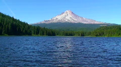 A wilderness lake and snow-capped mountain at Trillium Stock Footage