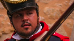 A soldier fires a musket at a reenactment of the Battle of Stock Footage