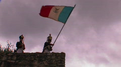 A soldier waves the Flag of Mexico at a reenactment of the - stock footage