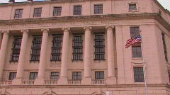 A flag blows in a breeze at the United States Post Office Stock Footage