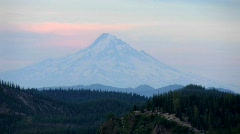 A mountain peak rises above a forest at Mt. St. Helens Stock Footage