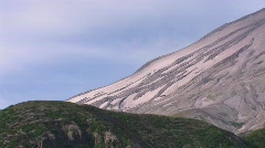 An arid mountainside rises above a grassy hillside at Mt. Stock Footage