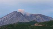 Smoke emits from a rocky mountain. Stock Footage