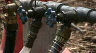 Close up of three water hose lines Stock Footage